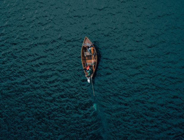 bird's-eye view of fishing boat in the ocean