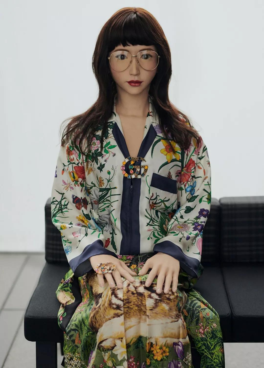 Young Asian female robot dressed in flowery robe and hipster glasses